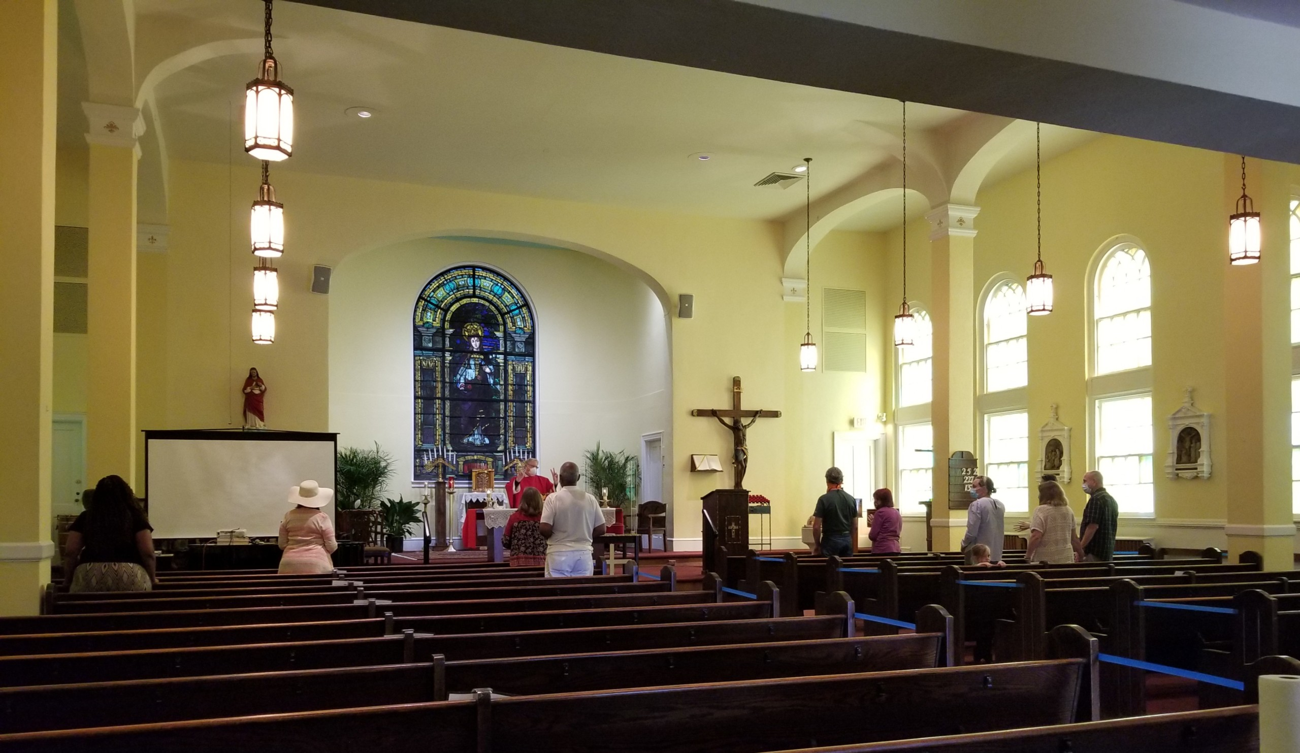 Interior of St. Elizabeth with people attending mass while social distancing